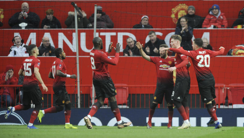Manchester United's players celebrate after scoring the opening goal during the English FA Cup third round soccer match between Manchester United and Reading at Old Trafford in Manchester, England, Saturday, Jan. 5, 2019. (AP Photo/Rui Vieira)