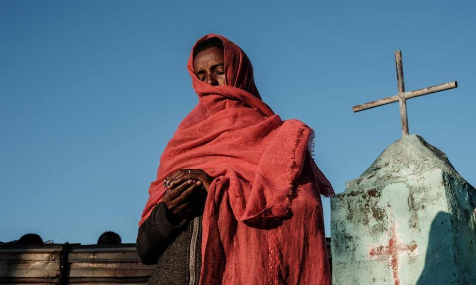 An Ethiopian refugee who fled the Tigray conflict prays during Sunday Mass at an Ethiopian Orthodox church in eastern Sudan.