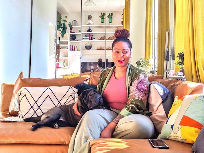 Tiara Christian in her London apartment with her dog Sweet Potato.