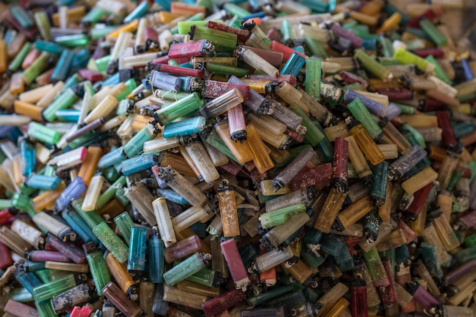 A pile of thousands of multicoloured lighters collected from Djulpan Beach.