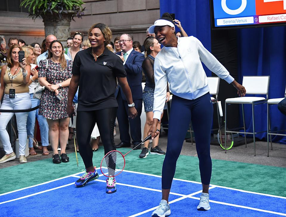 The superstar sisters seemed to be having fun on the court.