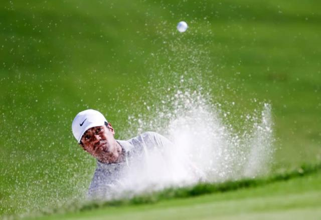 FILE PHOTO: Tony Finau plays a shot from a bunker on the seventh hole during the second round of the Charles Schwab Challenge at Colonial Country Club, Texas.