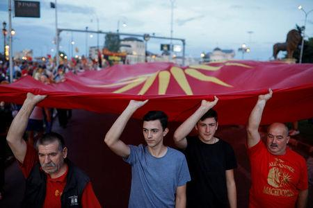 Supporters of opposition party VMRO-DPMNE carry a big Macedonian flag as they take part in a protest over compromise solution in Macedonia's dispute with Greece over the country's name, in Skopje, Macedonia, June 2, 2018. REUTERS/Marko Djurica