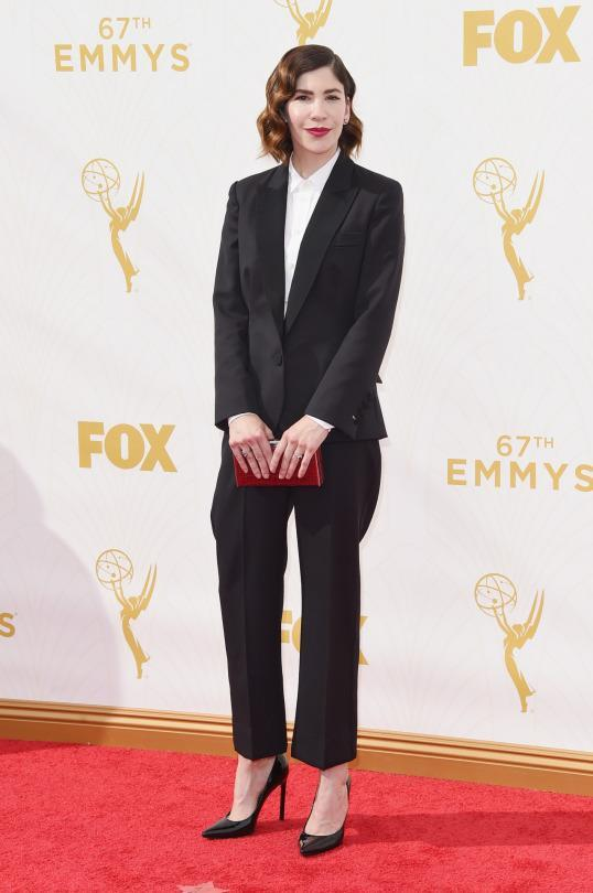 """<p>How to do menswear right: Carrie Brownstein. The """"Portlandia"""" star paired tapered black pants with high heels and styled her hair in some Old Hollywood curls.<br></p>"""