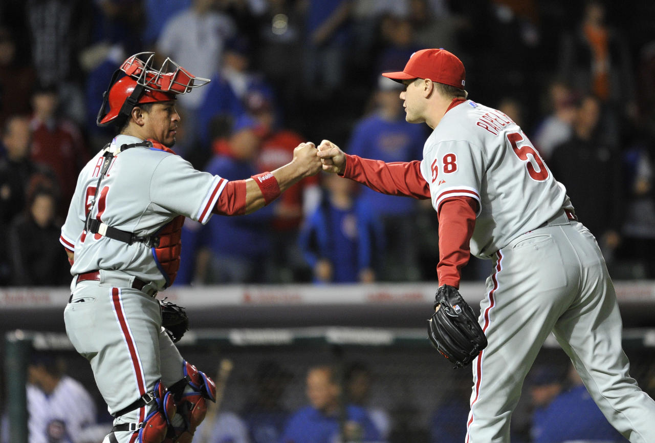 Philadelphia Phillies catcher Carlos Ruiz, left, and relief pitcher Jonathan Papelbon celebrate their win over the Chicago Cubs after a baseball game on Thursday, May 17, 2012 in Chicago. The Phillies won 8-7. (AP Photo/Brian Kersey)
