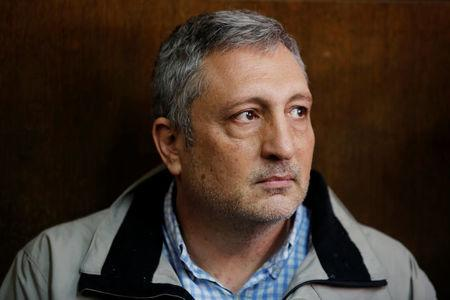 FILE PHOTO: Nir Hefetz sits in the Magistrate Court during his remand hearing in Tel Aviv, Israel, February 22, 2018. REUTERS/Amir Cohen/File Photo