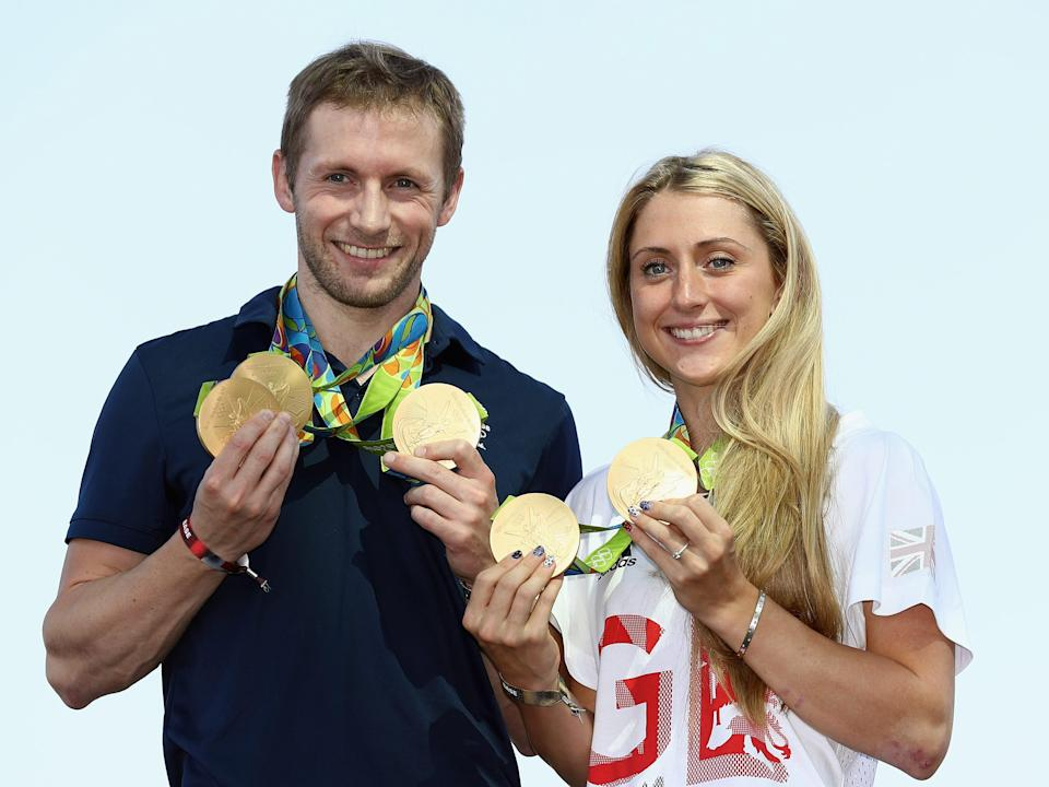 Laura Trott and Jason Kenny hold their gold medals at the 2016 Olympics in Rio.