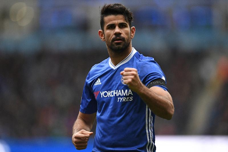 Chelsea's Brazilian-born Spanish striker Diego Costa celebrates scoring his team's first goal during the English Premier League football match between Manchester City and Chelsea at the Etihad Stadium in Manchester on December 3, 2016