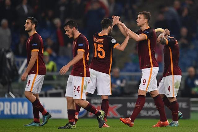 Roma's forward from Edin Dzeko (2ndR) celebrates with teammate Miralem Pjanic after scoring during the UEFA Champions League football match AS Roma vs Bayer Leverkusen on November 4, 2015 at the Olympic stadium in Rome (AFP Photo/Andreas Solaro)