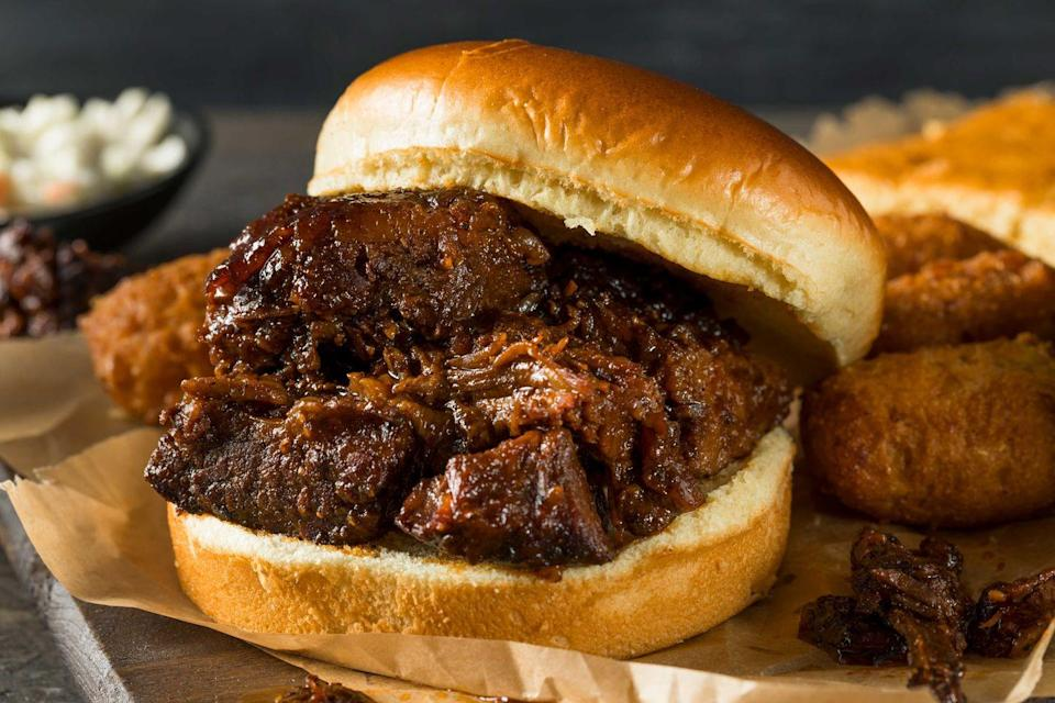 "<p><strong>Burnt End Sandwich</strong></p><p>While ribs and brisket take the spotlight in one of America's barbecue capitals, the local speciality is burnt ends. It's all about the crisp crunch at <a href=""https://www.burntendbbq.com/"" rel=""nofollow noopener"" target=""_blank"" data-ylk=""slk:Burnt End BBQ"" class=""link rapid-noclick-resp"">Burnt End BBQ</a>, with these charred, fattier ends from the point section of the brisket -- covered in sauce, it's irresistible. </p>"