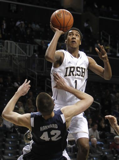 Notre Dame's Cameron Biedscheid (1) is fouled as he shoots against Brigham Young's Ian Harward (42) during the first half of their NCAA college basketball game in the consolation round of the Coaches vs. Cancer Classic at the Barclays Center, Saturday, Nov. 17, 2012, in New York. (AP Photo/Jason DeCrow)