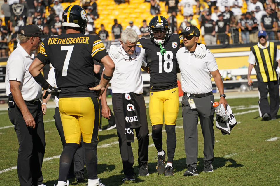 Pittsburgh Steelers quarterback Ben Roethlisberger (7) watches as wide receiver Diontae Johnson (18) is helped off the field after being injured during the second half of an NFL football game against the Las Vegas Raiders in Pittsburgh, Sunday, Sept. 19, 2021. (AP Photo/Keith Srakocic)