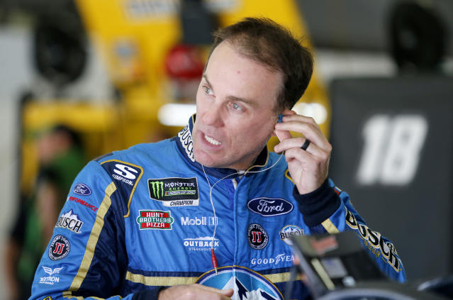 "<a class=""link rapid-noclick-resp"" href=""/nascar/sprint/drivers/205/"" data-ylk=""slk:Kevin Harvick"">Kevin Harvick</a> puts in an ear piece as he prepares to practice for the NASCAR Cup Series auto race Saturday, July 21, 2018, at New Hampshire Motor Speedway in Loudon, N.H. (AP Photo/Mary Schwalm)"