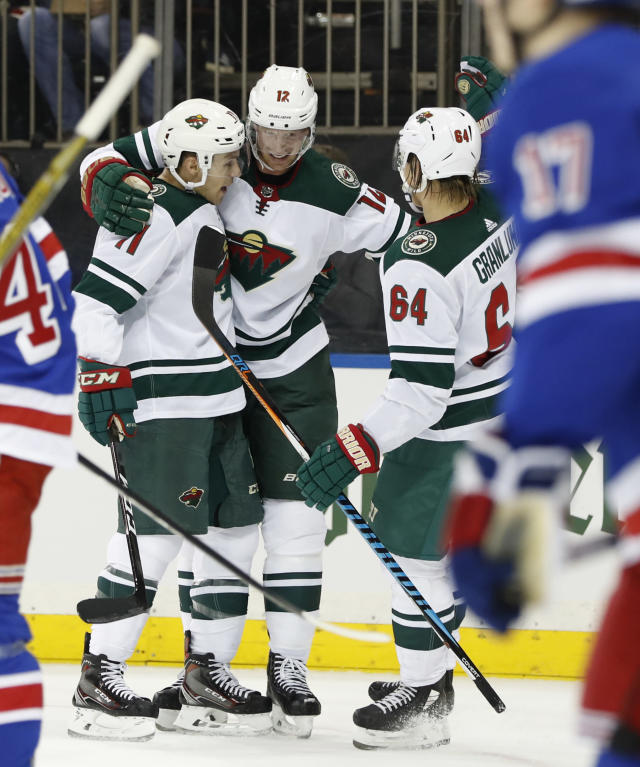 Minnesota Wild left wing Zach Parise (11), center Eric Staal (12), and right wing Mikael Granlund (64) celebrate after Granlund scored a goal during the first period of an NHL hockey game against the New York Rangers in New York, Friday, Feb. 23, 2018. (AP Photo/Kathy Willens)