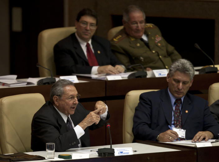 Newly appointed Cuba's Vice-President Miguel Diaz-Canel, bottom center, and Cuba's President Raul Castro, bottom left, participate in the closing session of the National Assembly in Havana, Cuba, Sunday, Feb. 24, 2012. Raul Castro accepted a new five-year term that will be, he said, his last as Cuba's president and tapped rising star Diaz-Canel, 52, as vice-president and first in the line of succession. (AP Photo/Ramon Espinosa)