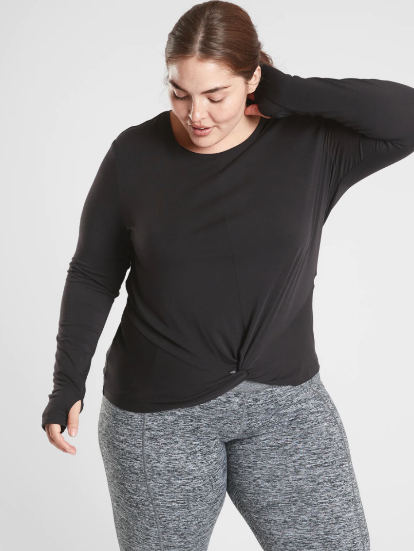 "<p><strong>Athleta</strong></p><p>athleta.gap.com</p><p><a href=""https://go.redirectingat.com?id=74968X1596630&url=https%3A%2F%2Fathleta.gap.com%2Fbrowse%2Fproduct.do%3Fpid%3D527201002%26pcid%3D999%26vid%3D1%26searchText%3Dtwist%2Bfront%23pdp-page-content&sref=https%3A%2F%2Fwww.bestproducts.com%2Ffitness%2Fclothing%2Fg33340287%2Fathleta-activewear-semi-annual-sale%2F"" rel=""nofollow noopener"" target=""_blank"" data-ylk=""slk:Shop Now"" class=""link rapid-noclick-resp"">Shop Now</a></p><p><del>$59</del><strong><br>$19.97</strong></p><p>Want to get a head-start on your fall shopping? Add this top to your cart. With built-in thumb holes and a stylish twist detailing, this shirt bridges the gap between form and function. </p>"