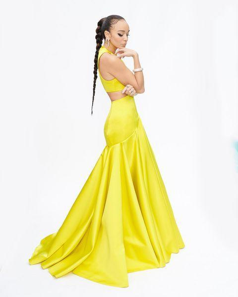 """<p>Madekwe wore a yellow cut-out custom dress by Louis Vuitton.</p><p><a href=""""https://www.instagram.com/p/CNiFm_8LPbP/"""" rel=""""nofollow noopener"""" target=""""_blank"""" data-ylk=""""slk:See the original post on Instagram"""" class=""""link rapid-noclick-resp"""">See the original post on Instagram</a></p>"""
