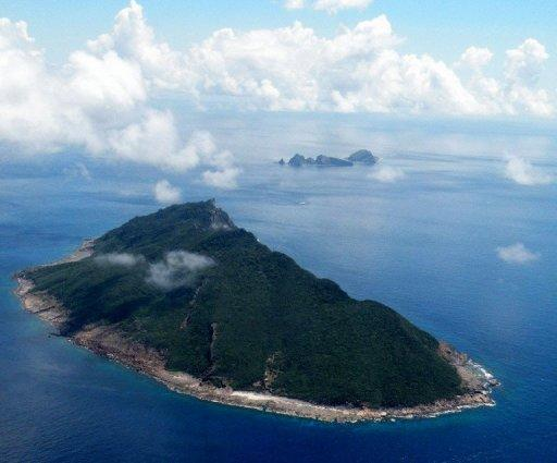 <p>This file aerial shot, taken in 2010, shows the disputed islands known as Senkaku in Japan and Diaoyu in China, in the East China Sea. Six Chinese government ships sailed into waters around the disputed islands early Friday, the Japanese coastguard said, adding it had issued warnings telling them to leave.</p>