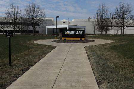 FILE PHOTO: A Caterpillar corporate logo is pictured in front of a building in Peoria, Illinois, U.S., March 19, 2017.   REUTERS/Carlo Allegri/File Photo