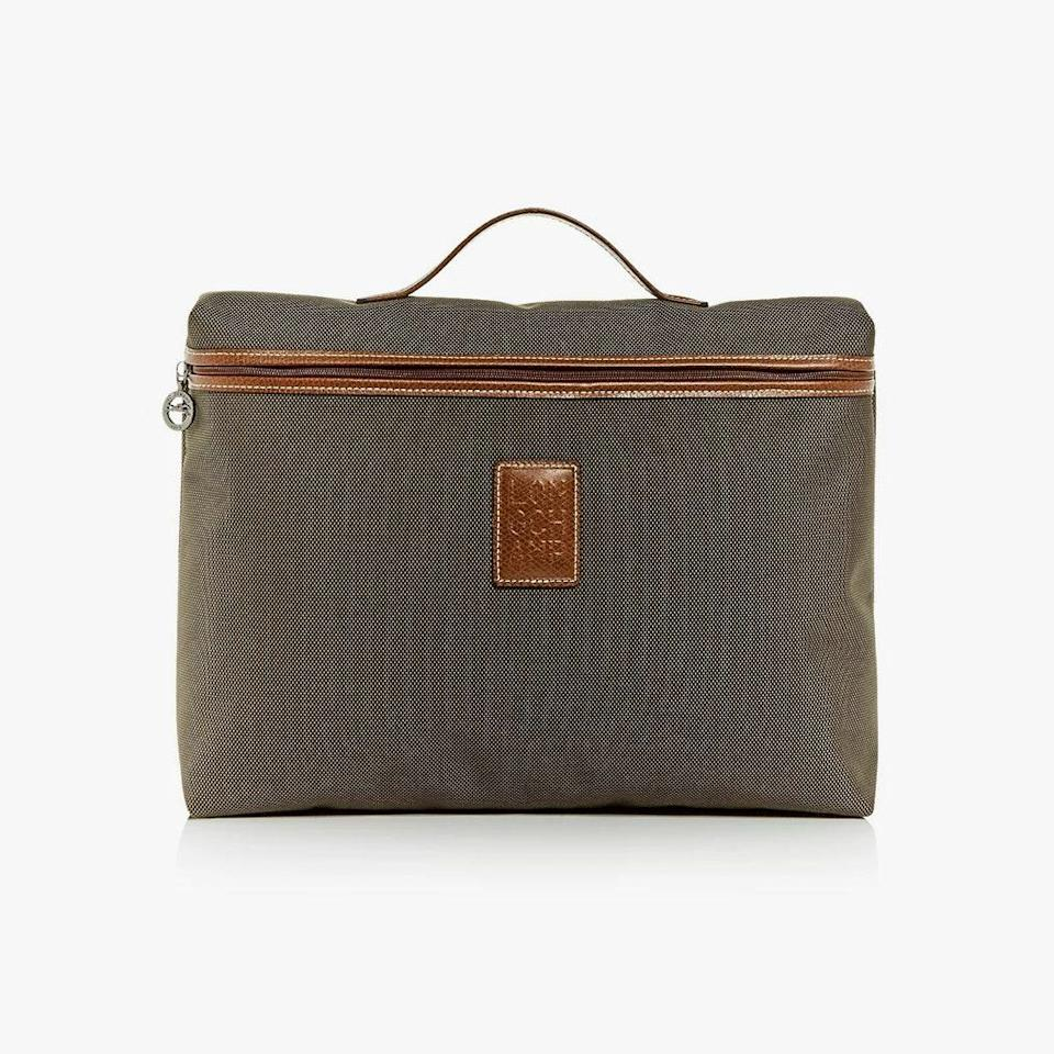 """$130, BLOOMINGDALE'S. <a href=""""https://www.bloomingdales.com/shop/product/longchamp-boxford-canvas-briefcase?ID=3708841&CategoryID=3864"""" rel=""""nofollow noopener"""" target=""""_blank"""" data-ylk=""""slk:Get it now!"""" class=""""link rapid-noclick-resp"""">Get it now!</a>"""