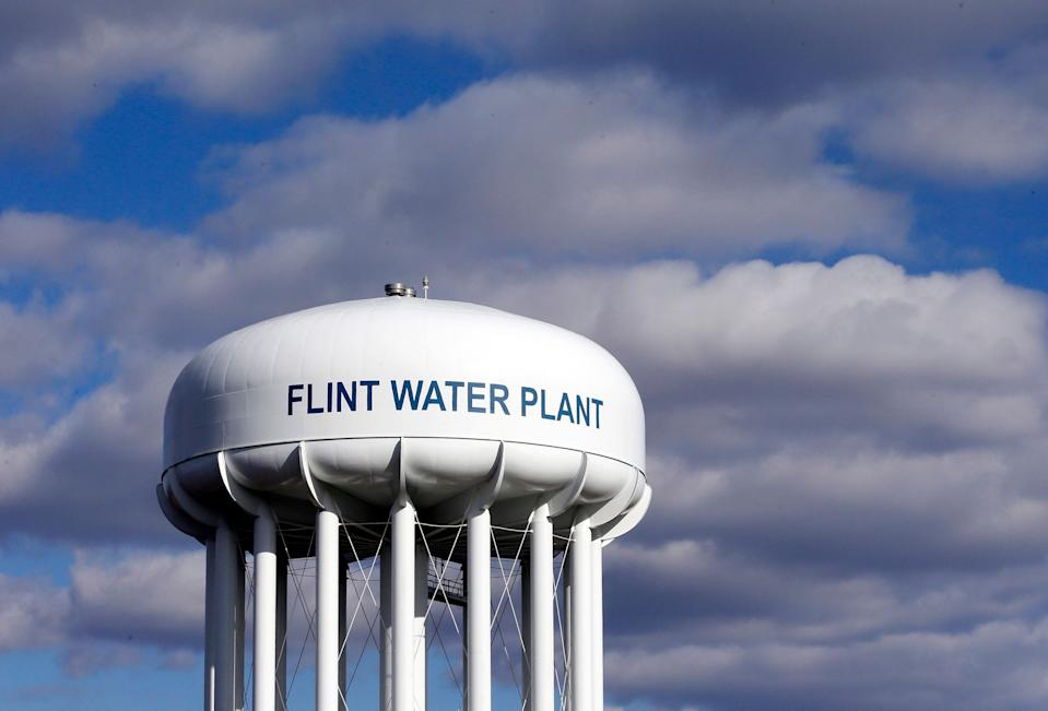 FILE - In this March 21, 2016 file photo, the Flint Water Plant water tower is seen in Flint, Mich. Michigan environmental officials announced Tuesday, Jan. 24, 2017, that Flint's water system no longer has levels of lead exceeding the federal limit. The finding by the Department of Environmental Quality is good news for a city whose 100,000 residents have grappled with the man-made water crisis since 2014. (AP Photo/Carlos Osorio, File)