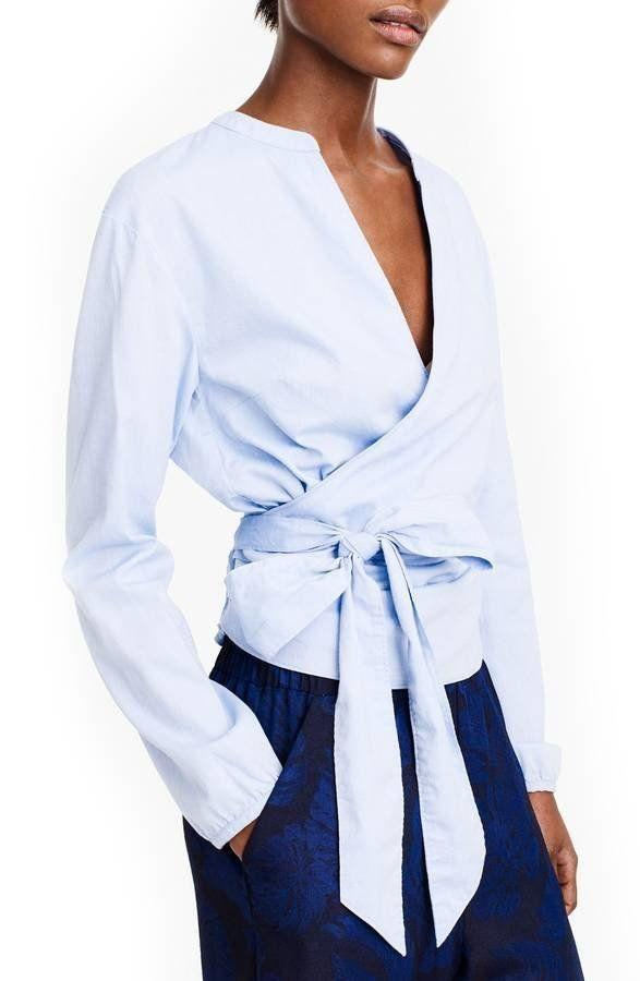 "Get it <a href=""https://shop.nordstrom.com/s/j-crew-sara-oxford-wrap-top/4881821?origin=category-personalizedsort&fashioncolor=OXFORD%20BLUE"" target=""_blank"">here</a>."