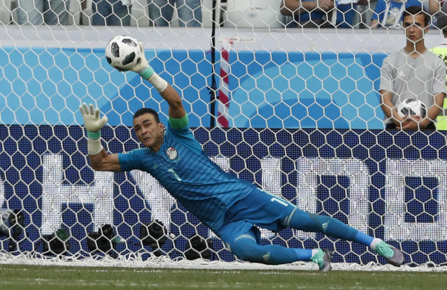 Egypt goalkeeper Essam El Hadary deflects a penalty during the group A match between Saudi Arabia and Egypt at the 2018 soccer World Cup at the Volgograd Arena in Volgograd, Russia, Monday, June 25, 2018. (AP Photo/Darko Vojinovic)