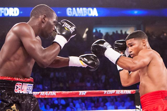 Terence Crawford's hard-fought win over Yuriorkis Gamboa (R) in June 2014 made him a star. (AP Photo)