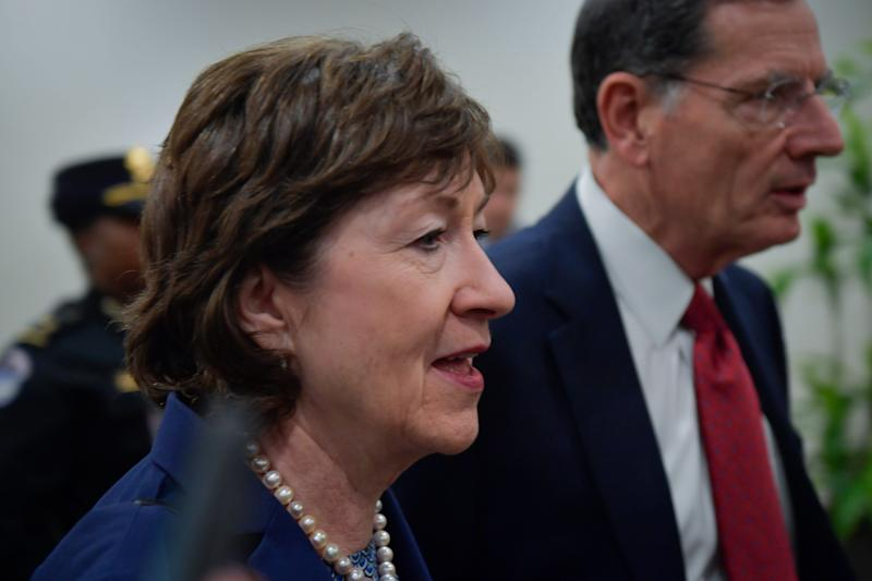 Senator Susan Collins, R-ME, and Senator John Barrasso, R-WY, on their way to the Senate chambers before the Senate acquitted President Donald Trump on two articles of impeachment on Wednesday, February 5, 2020.
