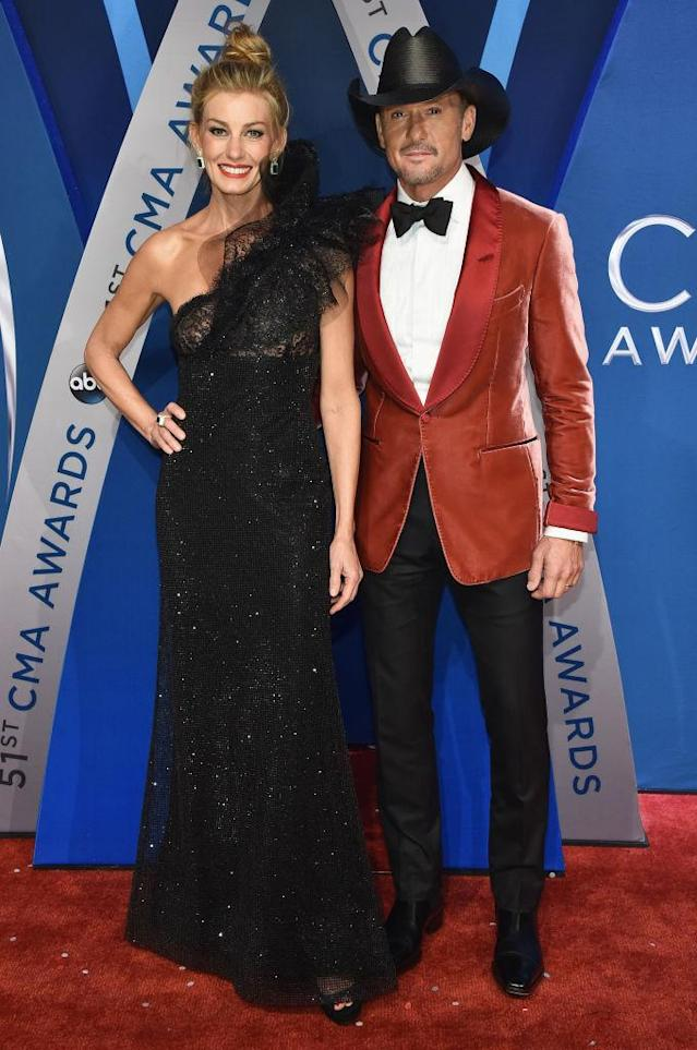 <p>Country's favorite couple did not disappoint, in black-and-red coordinated ensembles. (Photo: Getty Images) </p>