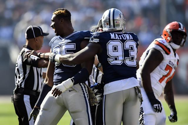 <p>Dallas Cowboys defensive tackle David Irving (95) reacts after fighting with Cleveland Browns center Cameron Erving (74) in the first half of an NFL football game, Sunday, Nov. 6, 2016, in Cleveland. (AP Photo/David Richard) </p>