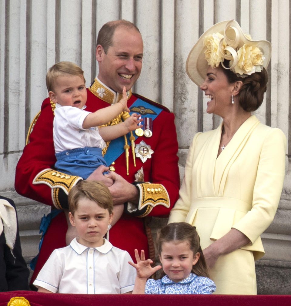 The Duke and Duchess of Cambridge with their children, Prince Louis, Prince George and Princess Charlotte, on the balcony of Buckingham Place as they watch the flypast following Trooping the Colour ceremony, as Queen Elizabeth II celebrates her official birthday.