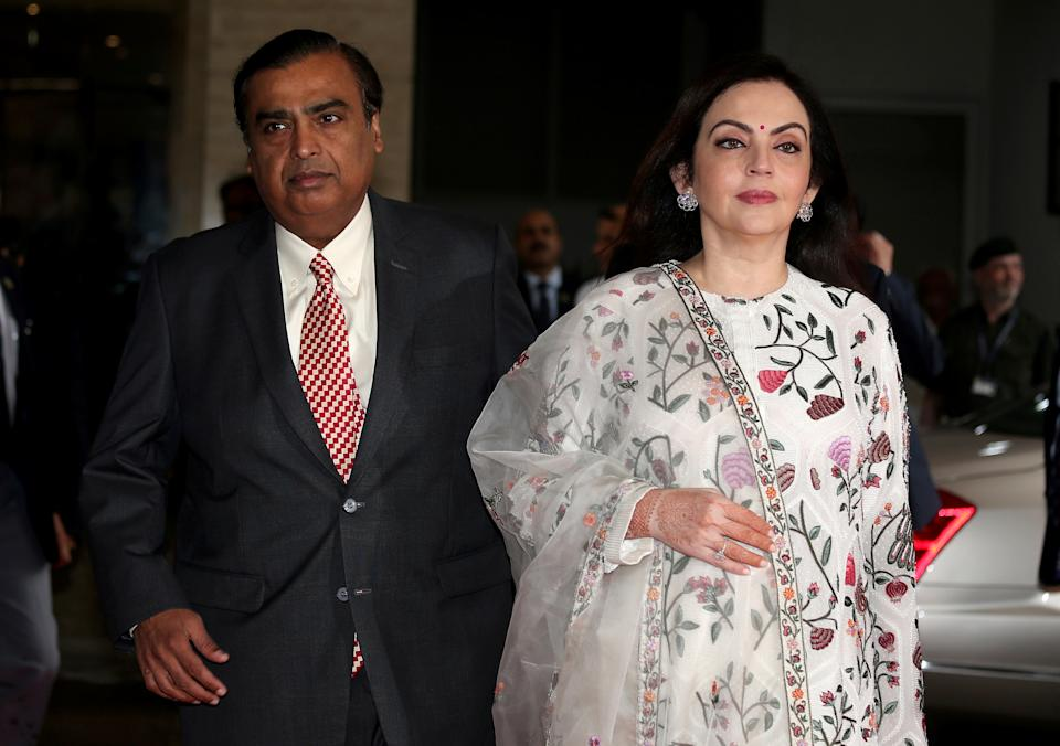 Mukesh Ambani, Chairman and CEO of Reliance Industries, arrives with his wife Nita Ambani to address the company's annual general meeting in Mumbai, India on July 5, 2018. REUTERS / Francis Mascarenhas