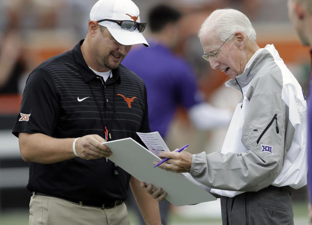 Texas head coach Tom Herman, left, presents a birthday card signed by Texas players and coaches to Kansas State head coach Bill Snyder, who is celebrating his birthday today, before their NCAA college football game, Saturday, Oct. 7, 2017, in Austin, Texas. Snyder is 78 today. (AP Photo/Eric Gay)