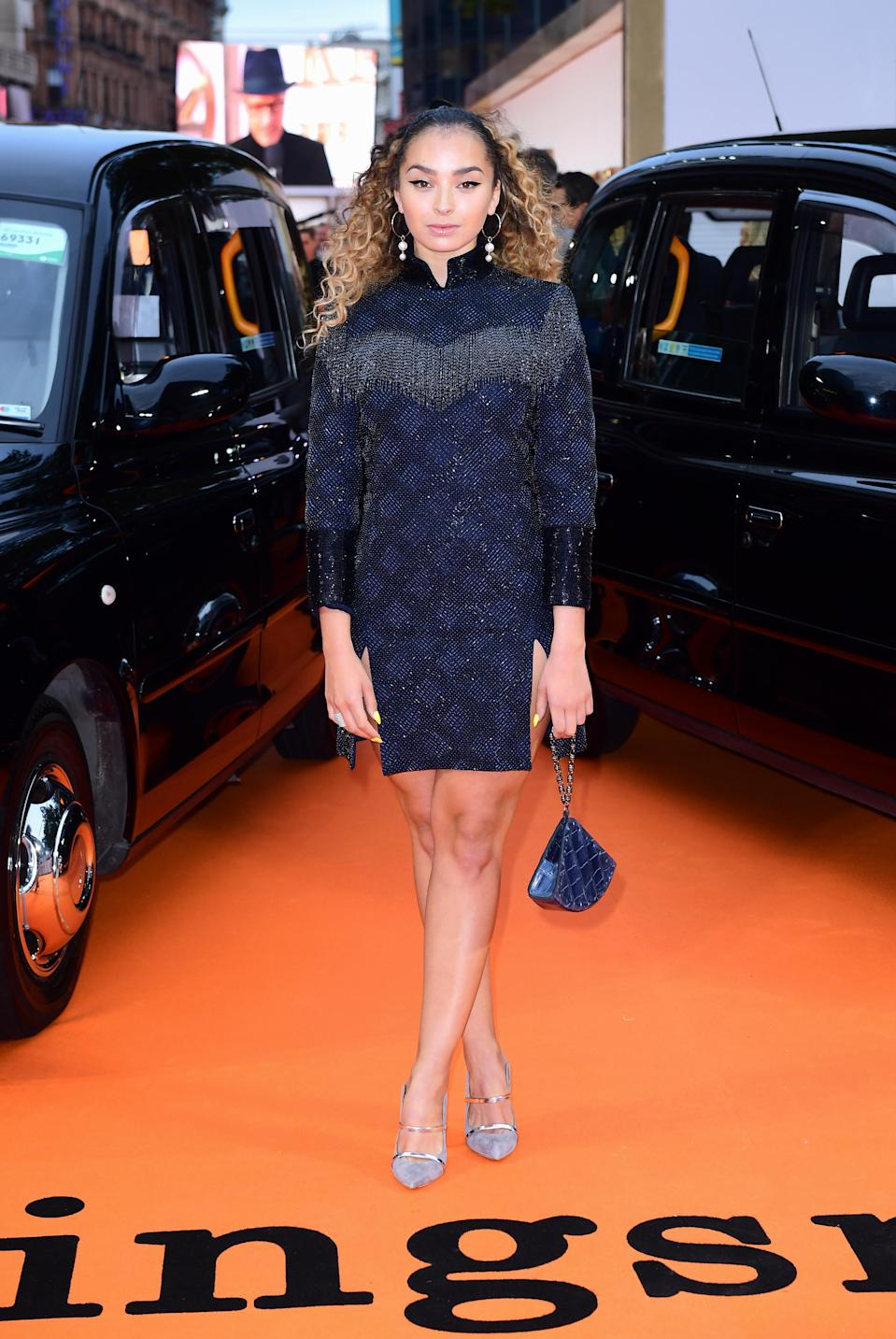 <p>Ella went for an oriental-style glittering mini dress.<br><i>[Photo: PA]</i> </p>