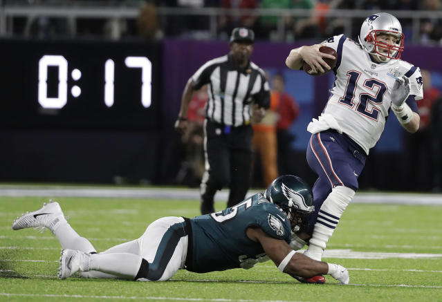 New England Patriots' Tom Brady (12) runs from Philadelphia Eagles' Brandon Graham during Super Bowl LII in Minneapolis.  (AP/Mark Humphrey)