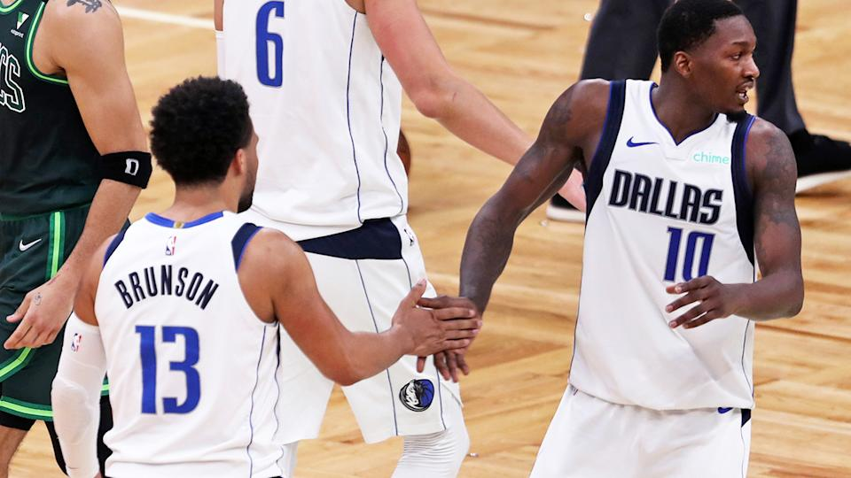 Jalen Brunson and Dorian Finney-Smith, pictured here in action for the Dallas Mavericks.