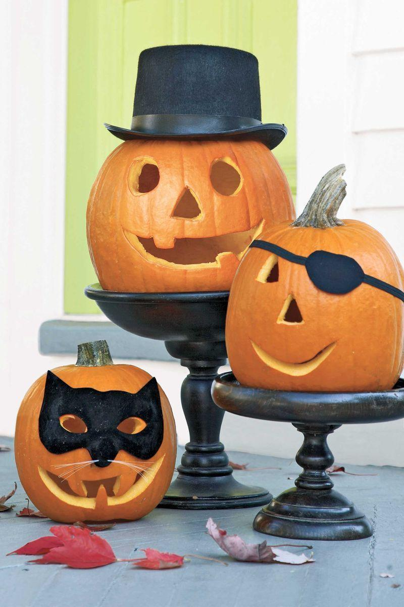 "<p>Real accessories like a black hat, <span class=""redactor-unlink"">eye patch,</span> or <span class=""redactor-unlink"">mask</span> add whimsy to carved pumpkins. Buy them at a party costume store, or make your own with felt, black construction paper and ribbon. Try posing them on cake stands — all the better for putting your pumpkins on a pedestal!<br><br><br><br><br>Want more Woman's Day? <a href=""https://subscribe.hearstmags.com/subscribe/womansday/253396?source=wdy_edit_article"" rel=""nofollow noopener"" target=""_blank"" data-ylk=""slk:Subscribe to Woman's Day"" class=""link rapid-noclick-resp"">Subscribe to Woman's Day</a> today and get <strong>73% off your first 12 issues</strong>. And while you're at it, <a href=""https://link.womansday.com/join/3o9/wdy-newsletter"" rel=""nofollow noopener"" target=""_blank"" data-ylk=""slk:sign up for our FREE newsletter"" class=""link rapid-noclick-resp"">sign up for our FREE newsletter</a> for even more of the Woman's Day content you want.<br><br><br></p>"