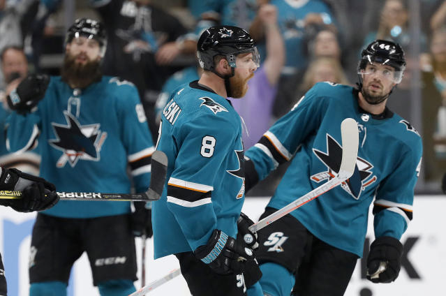 San Jose Sharks center Joe Pavelski (8) celebrates with teammates after the Sharks defeated the Colorado Avalanche in Game 7 of an NHL hockey second-round playoff series in San Jose, Calif., Wednesday, May 8, 2019. (AP Photo/Josie Lepe)