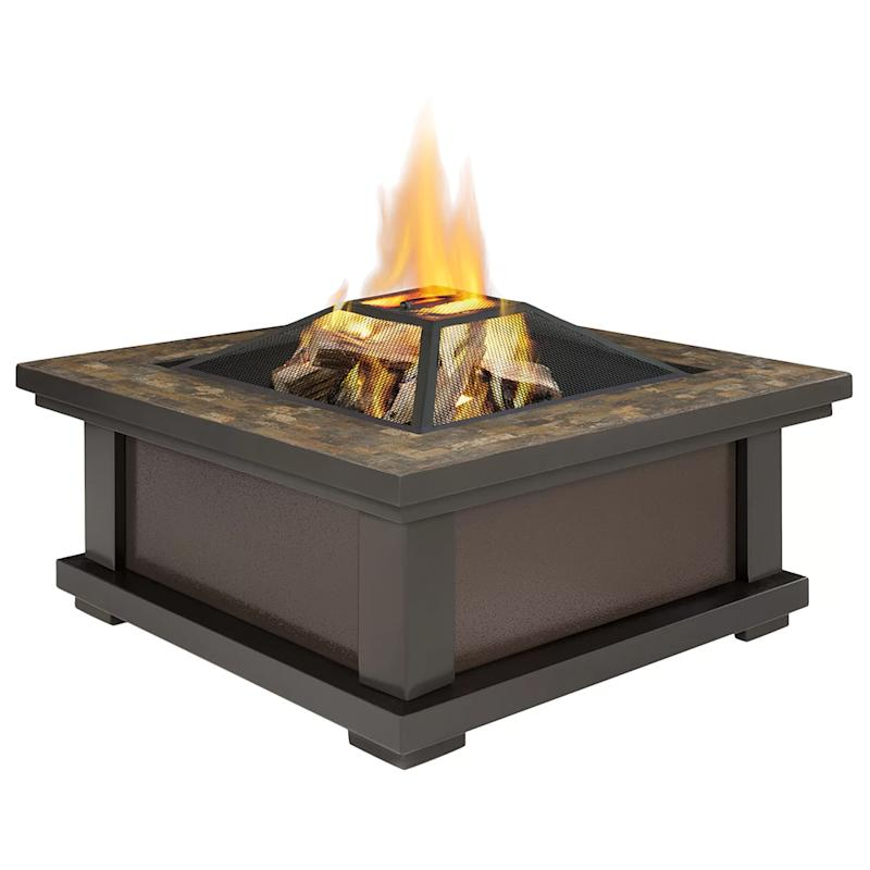This sleek fire pit also comes with a protective storage cover and log poker tool (Photo: Wayfair)