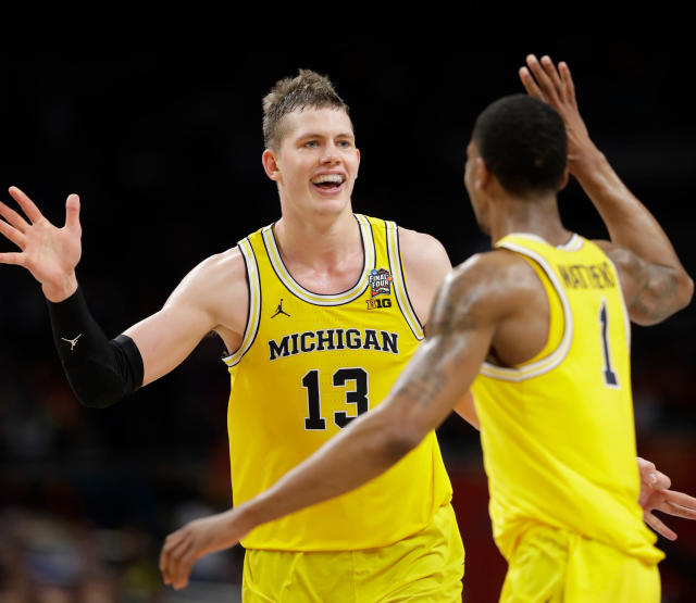 Michigan's Moritz Wagner (13) celebrates with Charles Matthews (1) during the second half in the semifinals of the Final Four NCAA college basketball tournament against Loyola-Chicago, Saturday, March 31, 2018, in San Antonio. (AP Photo/Eric Gay)