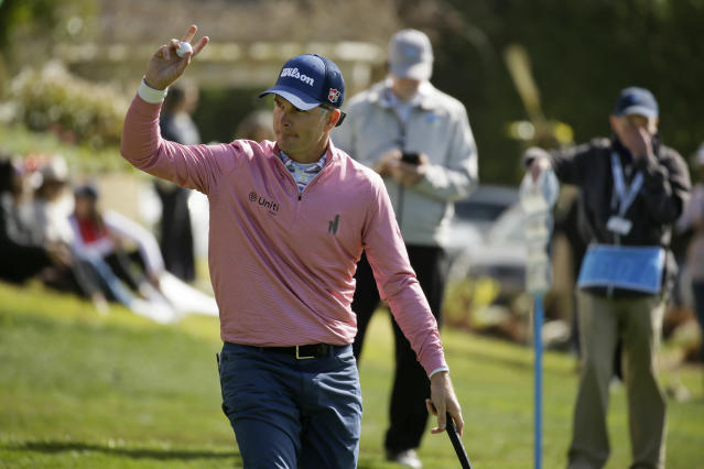 Kevin Streelman waves after making a birdie putt on the 14th green of the Pebble Beach Golf Links during the third round of the AT&T Pebble Beach National Pro-Am golf tournament Saturday, Feb. 8, 2020, in Pebble Beach, Calif. (AP Photo/Eric Risberg)