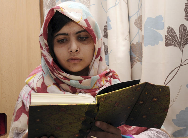 "FILE - In this undated file photo provided by Queen Elizabeth Hospital in Birmingham, England, Malala Yousufzai, the 15-year-old girl who was shot at close range in the head by a Taliban gunman in Pakistan, reads a book as she continues her recovery at the hospital. Malala Yousafzai, the Pakistani teenager shot in the head by the Taliban, is writing a memoir. Publisher Weidenfeld and Nicolson said Thursday March 28, 2013 it will release ""I am Malala"" in Britain this fall. Little, Brown will publish it in the United States.A Taliban gunman shot Malala on Oct. 9, while she was on her way home from school in northwestern Pakistan. (AP Photo/Queen Elizabeth Hospital, File)"