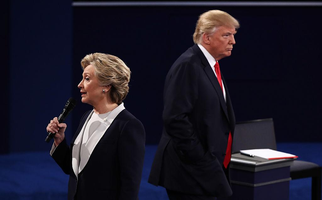 Democratic presidential nominee former Secretary of State Hillary Clinton speaks as Republican presidential nominee Donald Trump listens during the town hall debate at Washington University on Oct. 9, 2016 in St Louis, Missouri. | Win McNamee—Getty Images