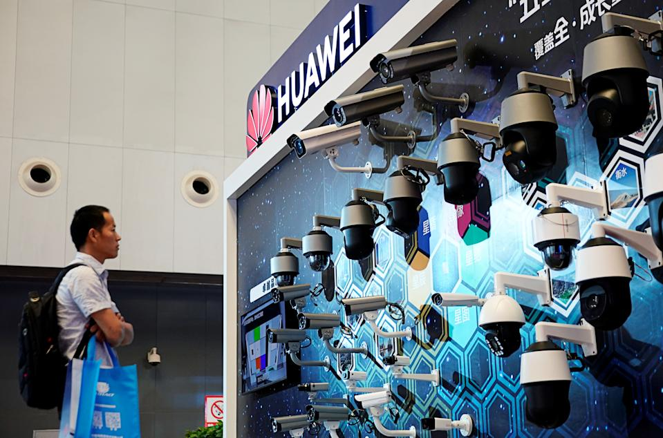 A man looks at surveillance cameras displayed at Huawei's booth at the security exhibition in Shanghai, China, May 24, 2019. REUTERS/Aly Song