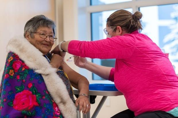 In January, Agnes Mills was the first person in Yukon to receive the COVID-19 vaccine. As of Monday, 27,153 people in the territory, or 76 per cent of the eligible adult population, had received at least their first shot. (Mark Kelly Photography/Government of Yukon - image credit)