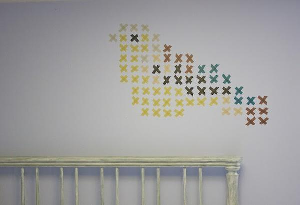 """<div class=""""caption-credit""""> Photo by: Becoming Gezellig</div><b>Washi Tape Cross-Stitch Wall Art</b> <br> This clever wall art idea is simple, customizable, and perfect for college because it doesn't harm the wall. This is important because most dorms have rules about making permanent changes to the room, so a temporary project like this will help you avoid some hefty fines."""