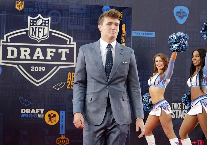 Missouri quarterback Drew Lock walks the red carpet ahead of the first round at the NFL football draft, Thursday, April 25, 2019, in Nashville, Tenn. (AP Photo/Steve Helber)