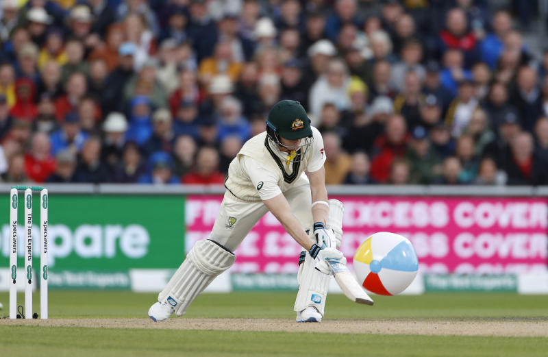Australia's Steve Smith clears a rubber ball that entered the field during day one of the fourth Ashes Test cricket match between England and Australia at Old Trafford in Manchester, England, Wednesday, Sept. 4, 2019. (AP Photo/Rui Vieira)