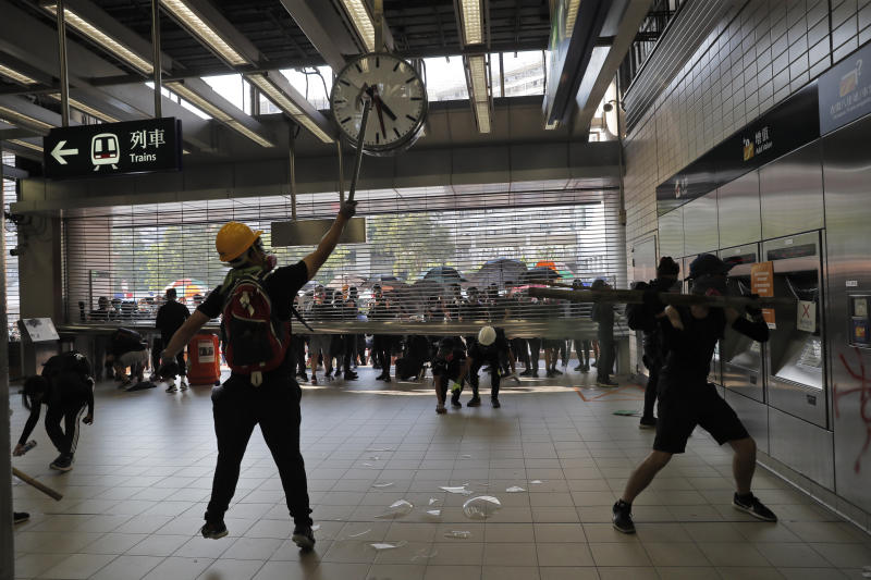 Anti-government protesters vandalize a MTR public transport station in Hong Kong, Oct. 1, 2019. In a fearsome escalation of violence, Hong Kong police shot a protester at close range in the chest Tuesday, leaving the teenager bleeding and howling on the ground. (Photo: Kin Cheung/AP)